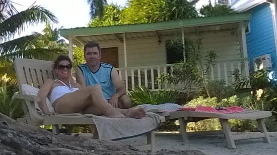 Shirley's Guest House: Relaxing on the sun lounger in front of our cabin