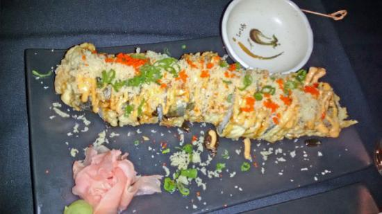 Rotonda West, FL: Noy's Roll...Salmon, Crab and Cream cheese Tempura battered and fried.