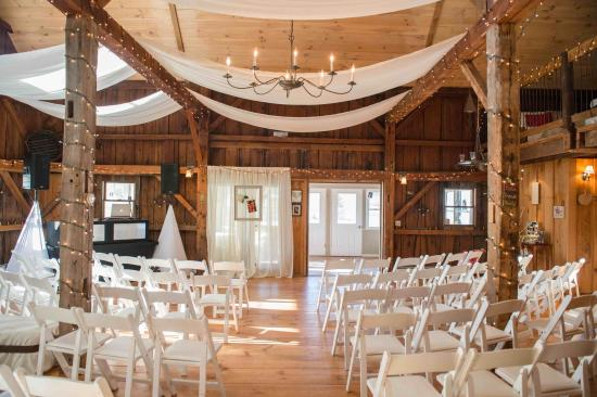 1824 House Inn: A bride and groom chose to hold their ceremony in our event barn. Later the chairs were removed