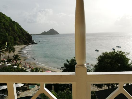 BodyHoliday Saint Lucia: View from our luxury ocean view room. Construction with backhoe was on the ridge on the left.