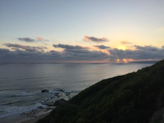 Wilderness, Sudafrica: sunset over flat rock
