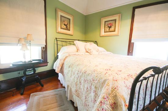 Emily's House B & B: This room features a queen sized bed elegantly appointed decor. Enjoy personal refrigerator and