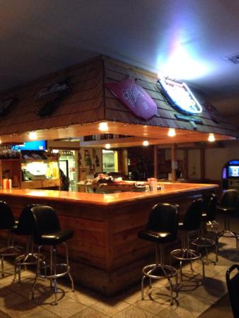 Akeley, MN: Picture of bar area along with front page of menu and the Stomping Burger