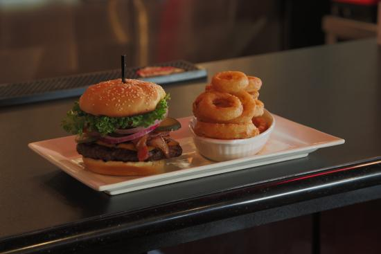 Symposium Cafe Restaurant & Lounge: Cheeseburger with bacon and onion rings