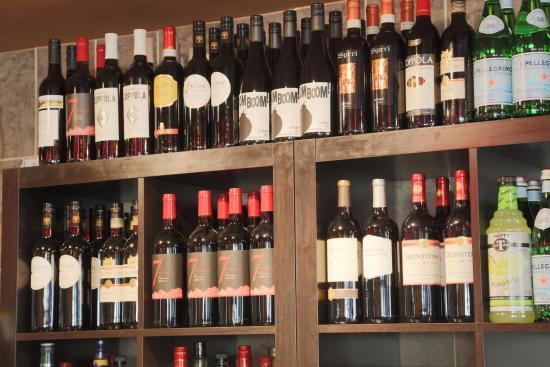 Symposium Cafe Restaurant & Lounge: Wine bottles display