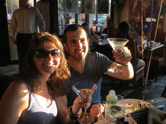 Symposium Cafe Restaurant & Lounge: Couple celebrating with martinis