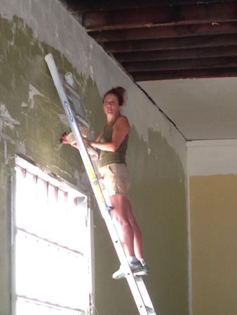 Sanctuary Brewing Company: Owner Lisa on ladder back in June 2015, painting the space that would become one-of-a-kind!