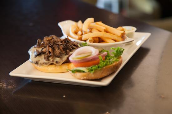 Symposium Cafe Restaurant & Lounge: Mushroom Swiss burger with fries