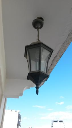 Lakis Court: pretty lamp on the balcony
