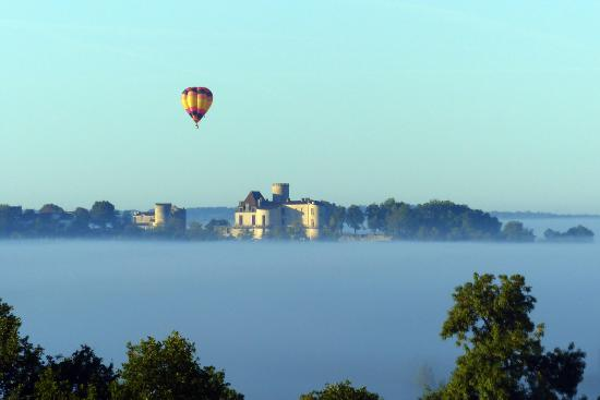 Vue de Duras: View of Duras Chateau from our terrace - early morning mist in the valley.