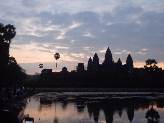Siem Reap Private Day Tours: Sunrise at Angkor Wat, see how the temple reflects at the man made lake