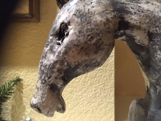 Perledo, Italia: part of horse head sculpture
