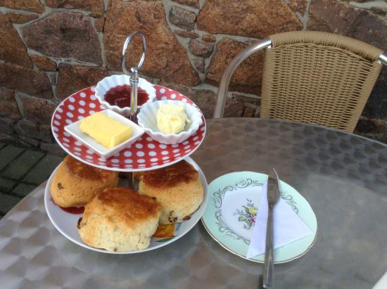 St. Peter, UK: Homemade Scone served with Classic Herd clotted cream and butter, and homemade Strawberry Jam