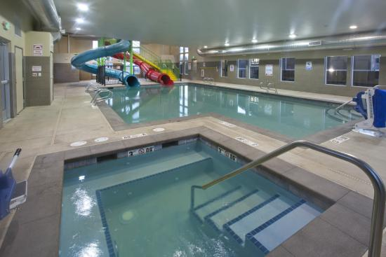 Indoor pool and hot tub with a slide  New Indoor Pool and Hot Tub with Slides - Picture of Red Lion Inn ...