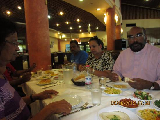 Tanureen: Fr. Marceline Depores & other members of the group from Malaysia enjoying the dishes.