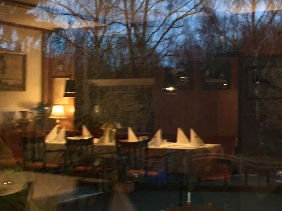 Norderstedt, Allemagne : View from inside reflection of the restaurant on the glass