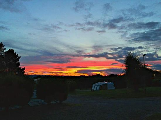 Tansley, UK: Sunset at Lickpenny Caravan Park.