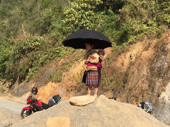 Vietnam Motorbike Tours - Day Trips: Local girl watches us