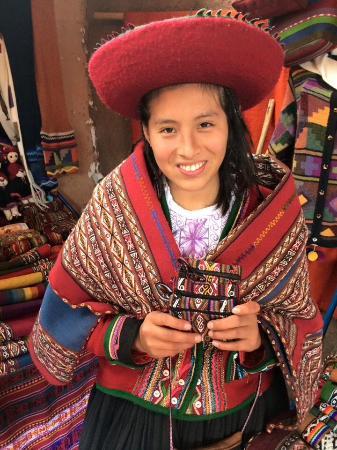 Chinchero, Peru: One of the young women weavers