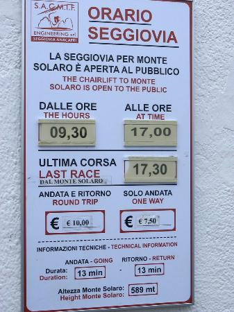 Mount Solaro: Mt. Solaro chairlift sign with times and prices