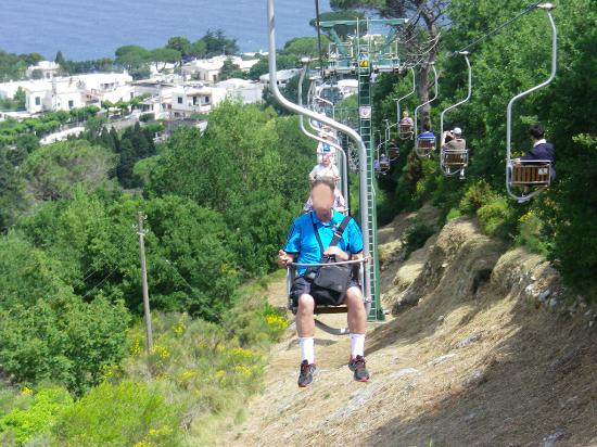 mt solaro chairlift sign with times and prices foto di monte