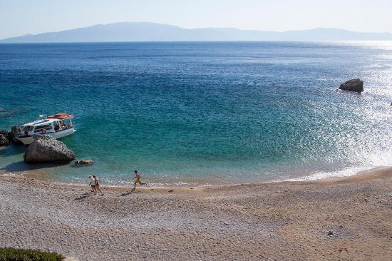 Irakleia, Greece: Karvounolakos is a small, isolated beach on Iraklia's southern coast, accessible by boat or sea