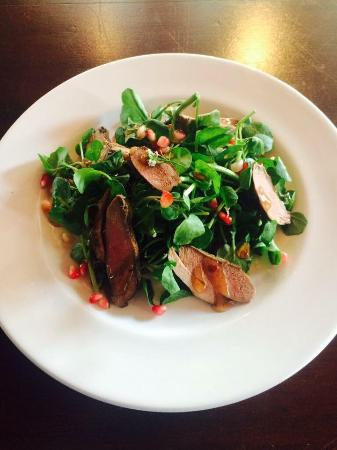 Cornworthy, UK: Seared wild wood pigeon, watercress & pomegranate salad, plum sauce.