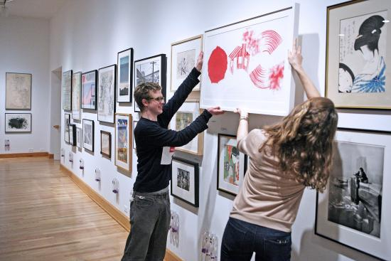 Williams College Museum of Art: A student selects a WALLS (Williams Art Loan for Living Spaces) work.