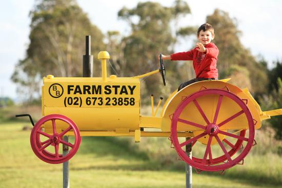 Glen Innes, Australia: The Yellow and Pink Tractor at the front entrance welcomes visitors
