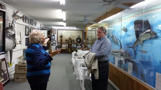 Destin History & Fishing Museum: Docent and guest at wall display showing life-size fish and major underwater topographic feature