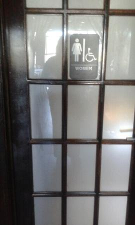 Glen Cove, NY: Ladies room door with handicapped signage.