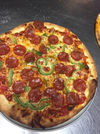 Cornelia, GA: New look in the dining room !  Hidden Mickey on my pizza.