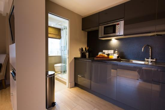 Nell Gwynn House Apartments: Modern style small studio kitchen area