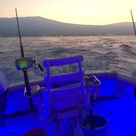 Sea Dancer: Leaving the harbor at dawn. Blue lights to light the cabin...