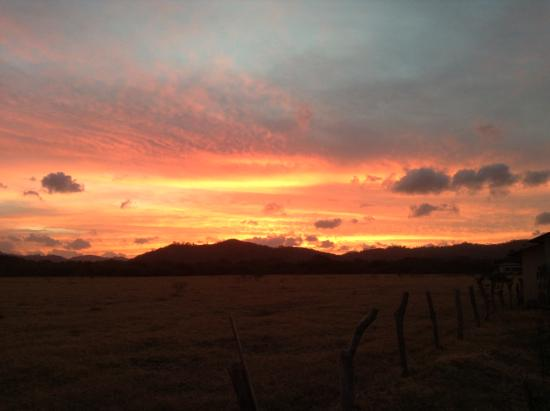 Tola, Nicaragua: sunrise over the mountains behind the house
