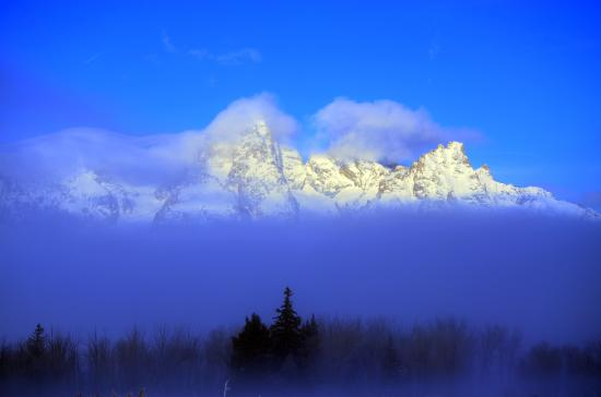 Jackson Hole Wildlife Safaris - Day Tours: The fog broke for us to see the Tetons