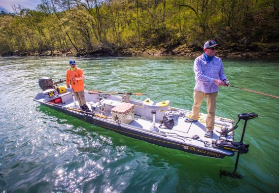 Searcy, AR: Beau Saunders fishing with a client on the Little Red River
