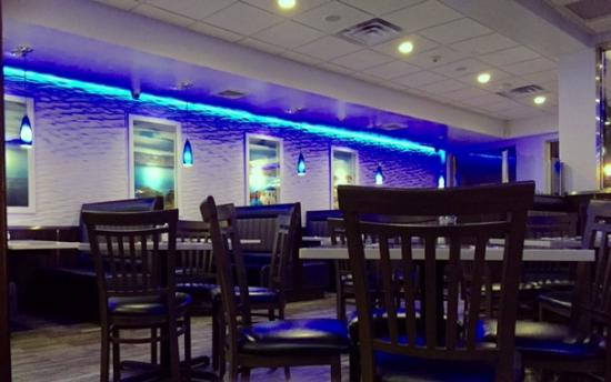 Merrick, NY: Cool, blue lighting against whitewashed walls.