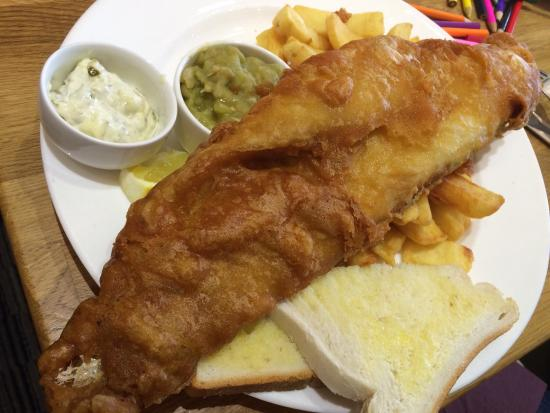 Grange-over-Sands, UK: The biggest piece of haddock I've ever seen served on a plate!!! 😆