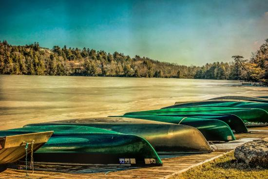 Eagles Mere, PA: The frozen lake and canoes awaiting a thaw.