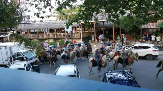 Papagayo Seafood : This is a picture from our second floor table watching the horse and bull parade in the street b