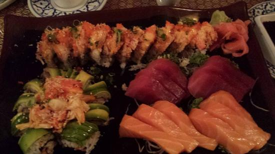 Amarit Thai Restaurant: Lava Roll (bottom left), Monster Roll (along the top), 2 orders of Tuna and Salmon sashimi.
