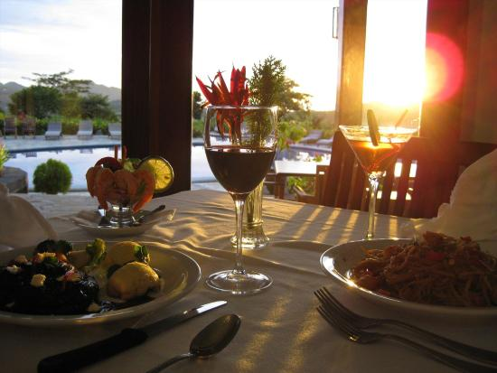 Villas de Palermo Hotel & Resort: Gourmet cuisine served poolside or in restaurant with A/C