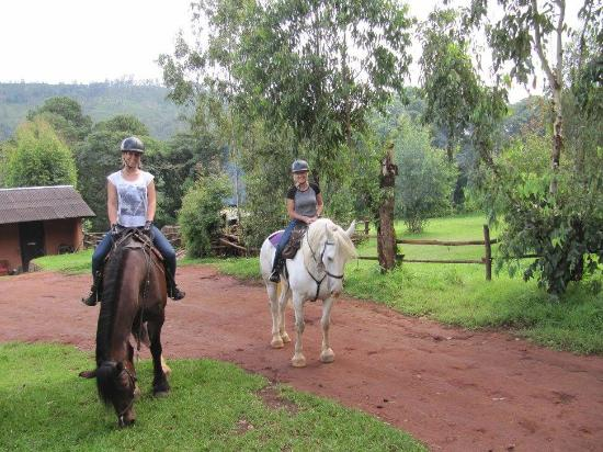 Zomba, Malawi: Hedera, my daughter, and myself leaving the stables