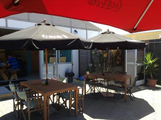 wood picnic table inside picture of wave cafe and courtyard rh tripadvisor com