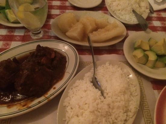 Huntington Station, NY: Oxtail stew with white rice & Yucca in garlic sauce & avo. All delicious. I don't like stew and