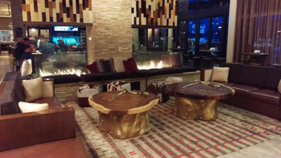 Westminster, CO: Hotel Lobby and the bar on the backside of fireplaces.