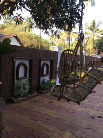 Naga Cottages: Swing chairs to chillax