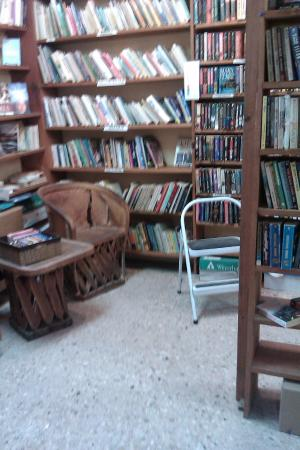 Stacks Of Books And Stool To Look At Names Top Shelf Picture Of