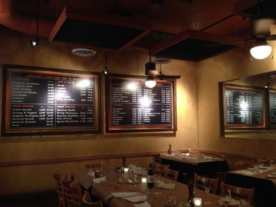 Carmine's on Penn: Interior and posted menu